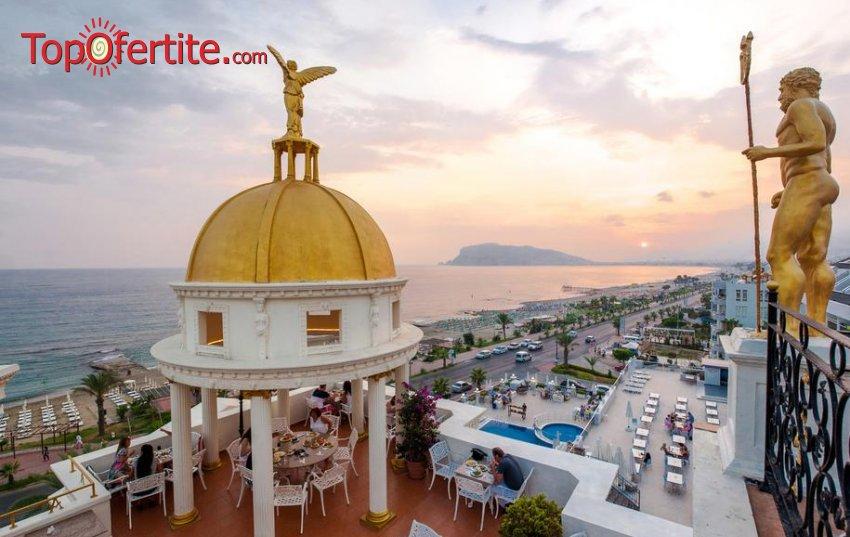 Почивка в Турция, Алания с полет на 21.06! 7 нощувки на база Ultra All Inclusive в хотел Antique Roman Palace 4*, самолетни билети, трансфер и летищни такси за 1078.50 лв на човек